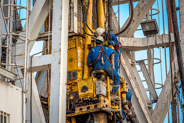 Drilling Rig Workers Photograph by Sasacvetkovic33