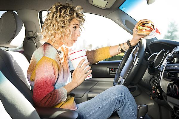 Eating Fast Food Hamburgers And Driving. Photograph by Jordan Siemens