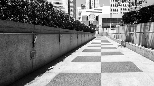 Empty Footpath Leading Towards Buildings On Sunny Day Photograph by Jesse Coleman / EyeEm