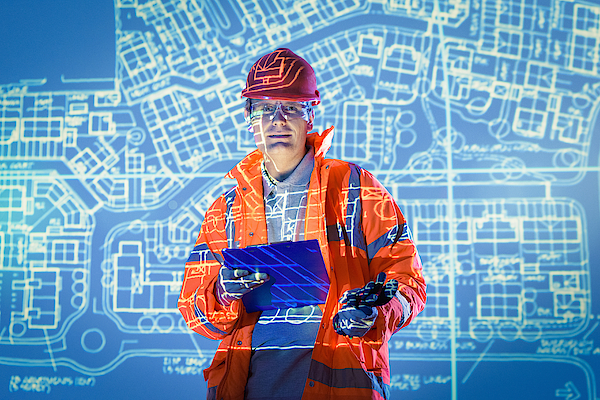 Engineer With Digital Tablet And Projected Plans, Portrait Photograph by Monty Rakusen