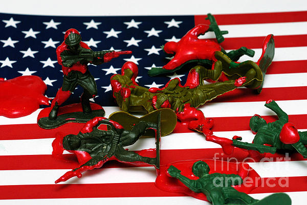 Aggression Photograph - Fallen Toy Soliders On American Flag by Amy Cicconi
