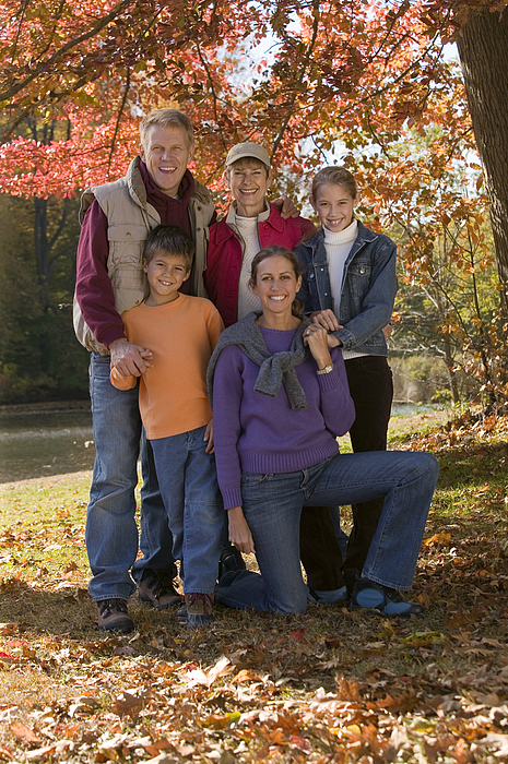 Family Portrait In Fall Foliage Photograph by Comstock Images