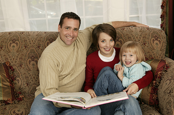 Family Reading Photograph by Comstock Images