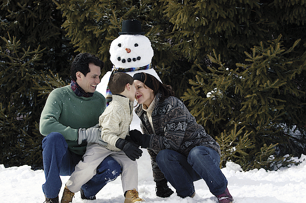 Family With Snowman Photograph by Comstock Images
