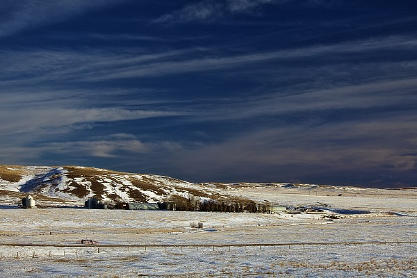 Light Photograph - Farm At Bottom Of Hill In Winter by Roberta Murray