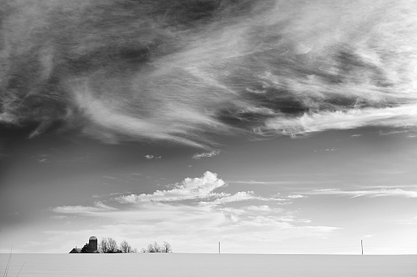 Light Photograph - Farm In The Distance In A Snowy Field by Patrick LaRoque