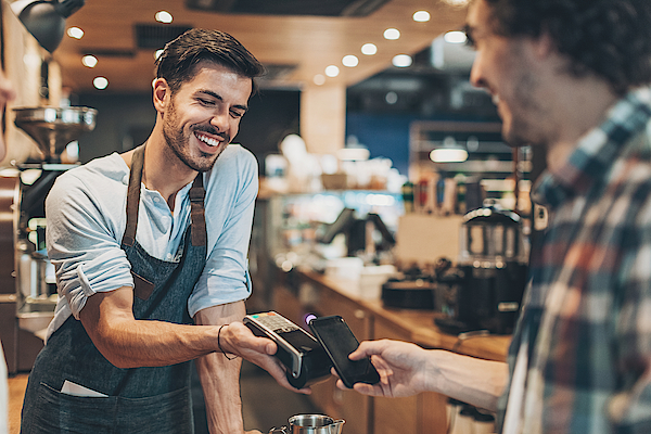 Fast And Easy Payment In The Coffee Shop Photograph by Pixelfit