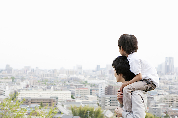 Father And Son On A Hill Photograph by Kohei Hara