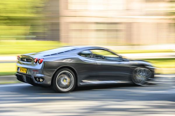 Ferrari F430 Italian Sports Car Driving At High Speed On A Road Photograph by Sjo