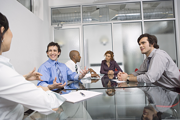 Five Businesspeople Sitting At Conference Table, Discussing Photograph by Bob Handelman