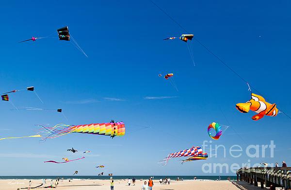 Kites Photograph - Flying Kites At St Augustine Beach Pier by Michelle Wiarda