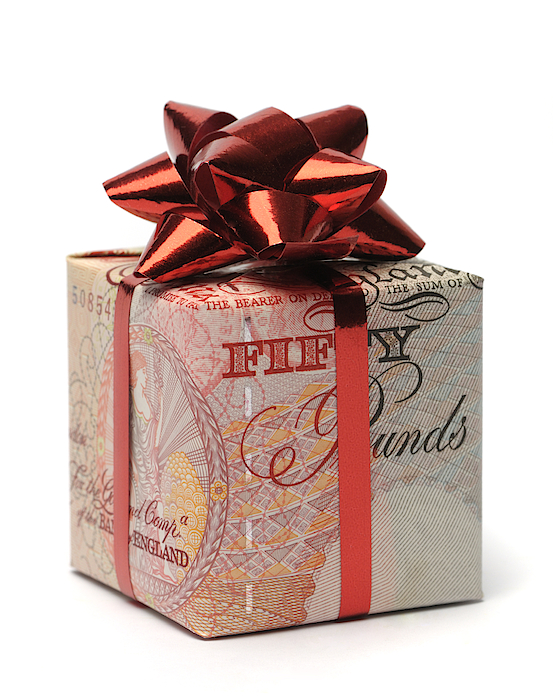 Gift Box Wrapped In An English Pound With A Red Bow Photograph by malamus-UK