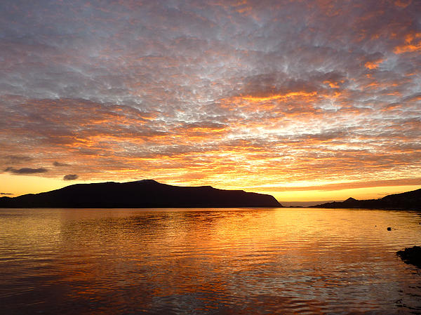 Sunset Photograph - Gilded Fjord While The Sun Set Over Norwegian Mountains by David Schoenheit