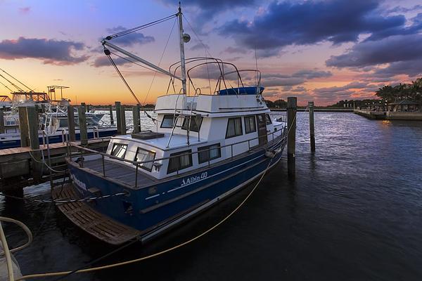 Boats Photograph - Good Fishing by Debra and Dave Vanderlaan