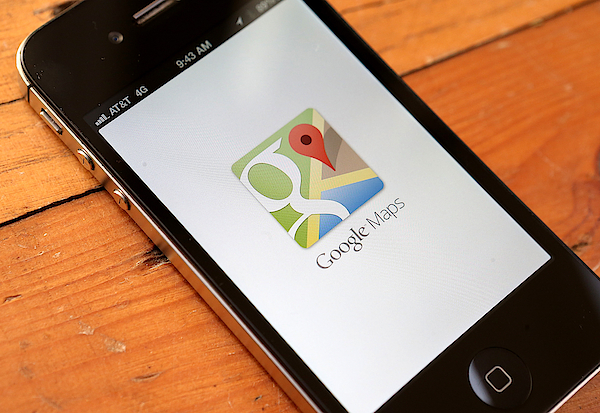 Google Maps Returns To Apples Iphone Photograph by Justin Sullivan