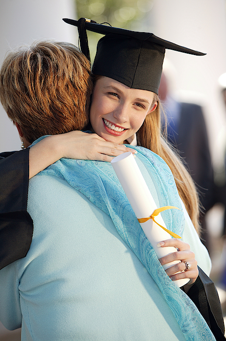 Graduate With Mother Photograph by Comstock Images