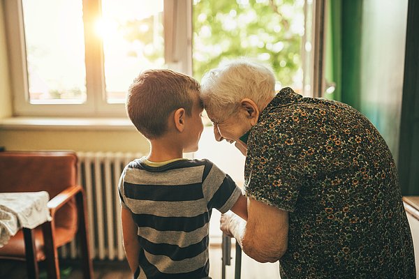 Grandson Visiting His Granny In Nursery Photograph by Supersizer