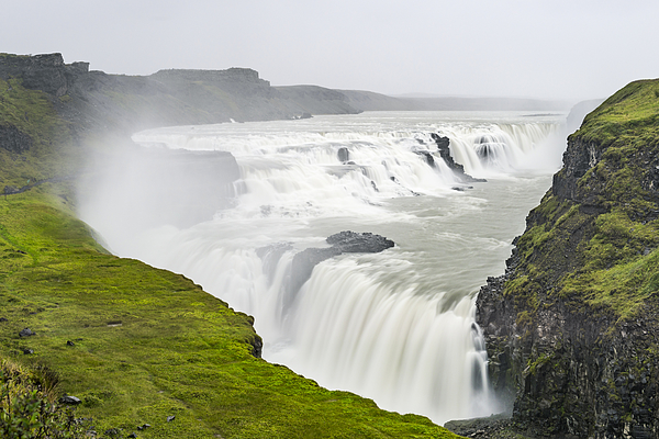 Gullfoss Waterfall In Iceland Seen From Above On A Cloudy Stormy Day Photograph by Sjo