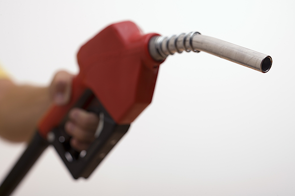 Hand Holding A Gas Pump Photograph by Comstock Images