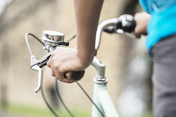 Hands Of Woman Commuting On Bicycle Photograph by Luxy Images