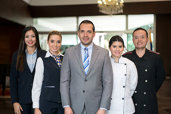 Happy Hotel Staff Photograph by Andresr