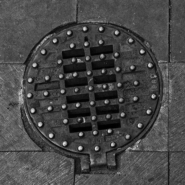 Manhole Cover Photograph - Hinged Manhole Cover by Lynn Palmer