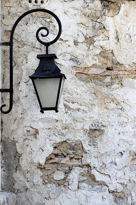 Hanging Photograph - Iron Lantern On A Old Brick Wall by Kamen Zagorov