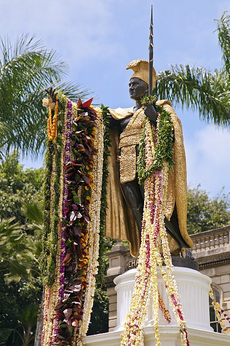 Blue Photograph - Kamehameha Covered In Leis by Brandon Tabiolo