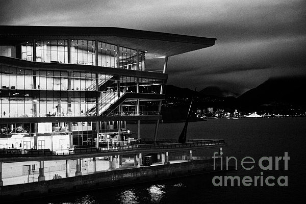Vancouver Photograph - late evening at the Vancouver convention centre west building on burrard inlet BC Canada by Joe Fox