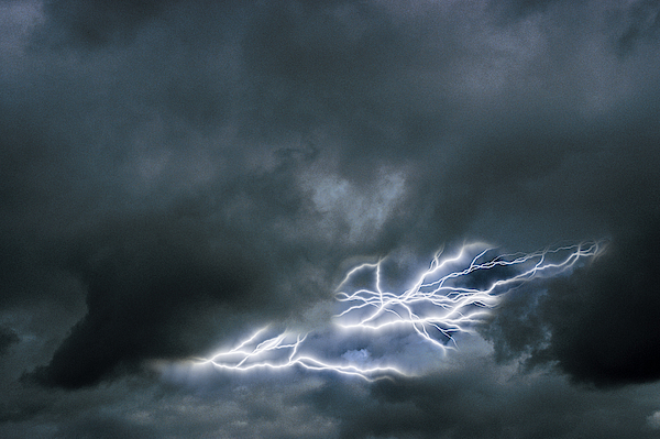 Lightning In A Cloudy Sky Photograph by Comstock