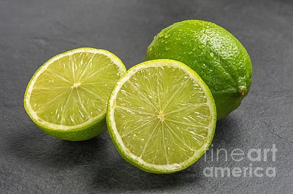 Lime Photograph - Limes On A Slate Plate by Palatia Photo