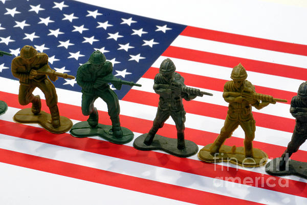 Aggression Photograph - Line Of Toy Soldiers On American Flag Crisp Depth Of Field by Amy Cicconi