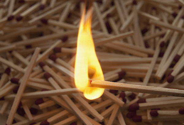 Lit Match On Top Of A Pile Of Wooden Matches Photograph by Mike Kemp