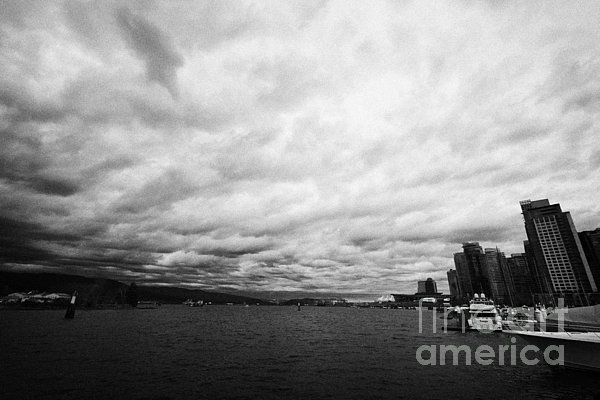 Looking Photograph - looking out from coal harbour into Vancouver Harbour on an overcast cloudy day BC Canada by Joe Fox