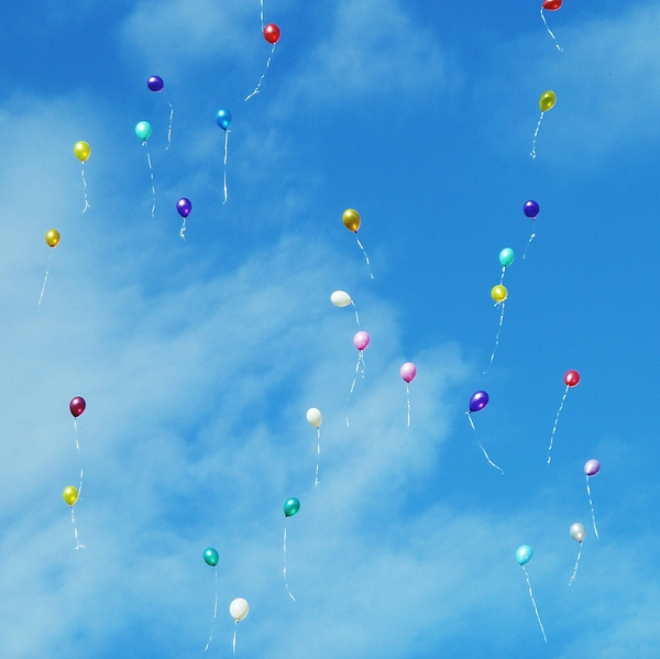 Low Angle View Of Balloons Flying Against Sky Photograph by Alexey Ivanov / EyeEm