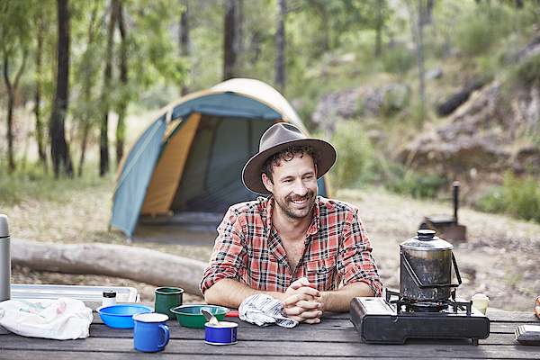 Man Cooking And Camping In Australian Bush Photograph by Stuart Miller