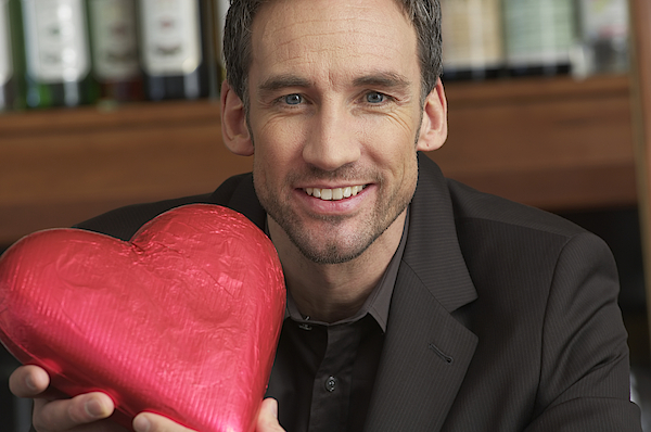 Man Holding A Chocolate Heart Photograph by Stock4b-rf