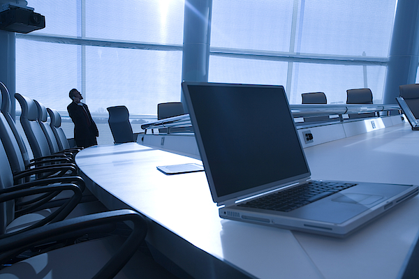 Man In Conference Room With Laptop Photograph by Comstock Images
