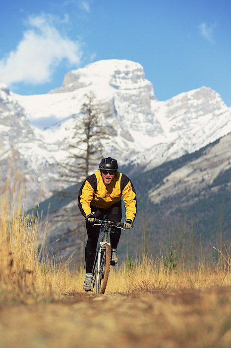 Man Mountain Biking In British Columbia , Canada Photograph by Comstock