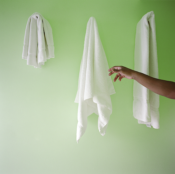 Man Reaching For Towel On Wall Photograph by Candace Gottschalk