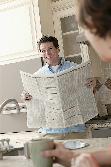 Man Reading Newspaper Photograph by Comstock Images