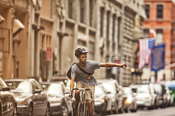 Man Riding Bicycle On City Street Photograph by Sam Edwards