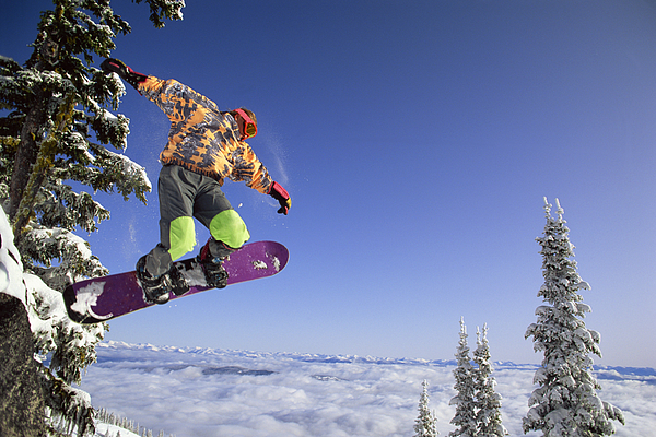 Man Snowboarding In British Columbia , Canada Photograph by Comstock