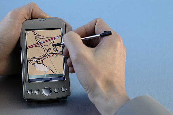 Man Using Gps System Photograph by Comstock