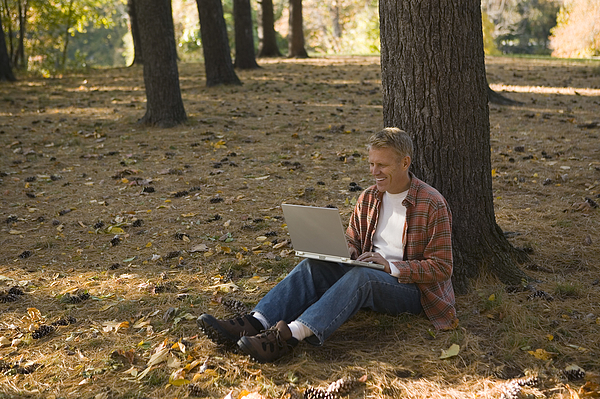 Man Using Laptop Outdoor Photograph by Comstock Images