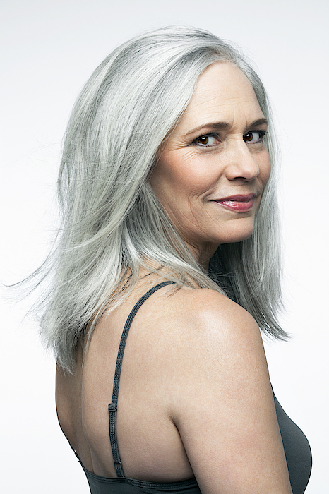 Mature Woman With Grey Hair In A 3/4 Position. Photograph by Andreas Kuehn