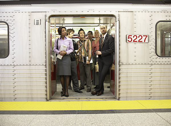 Medium Group Of People Standing In Subway Train Doorway Photograph by Darrin Klimek