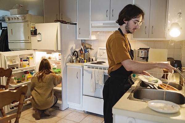 Millennial Couple Of Students Shared Living Doing Chores. Photograph by Martinedoucet