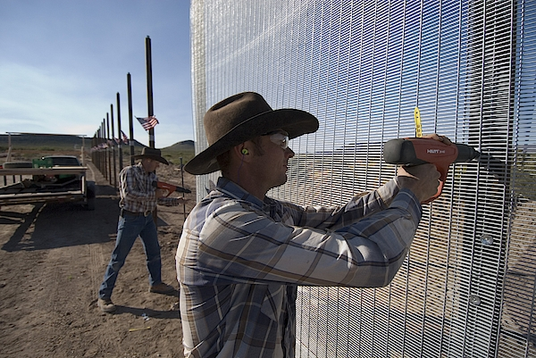 Minutemen Build Heavy Duty Border Fence Photograph by Gary Williams