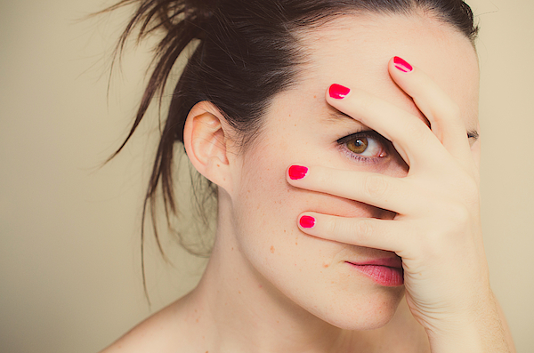 Misterious Girl With Red Nails And Hand On Face. Photograph by Volanthevist